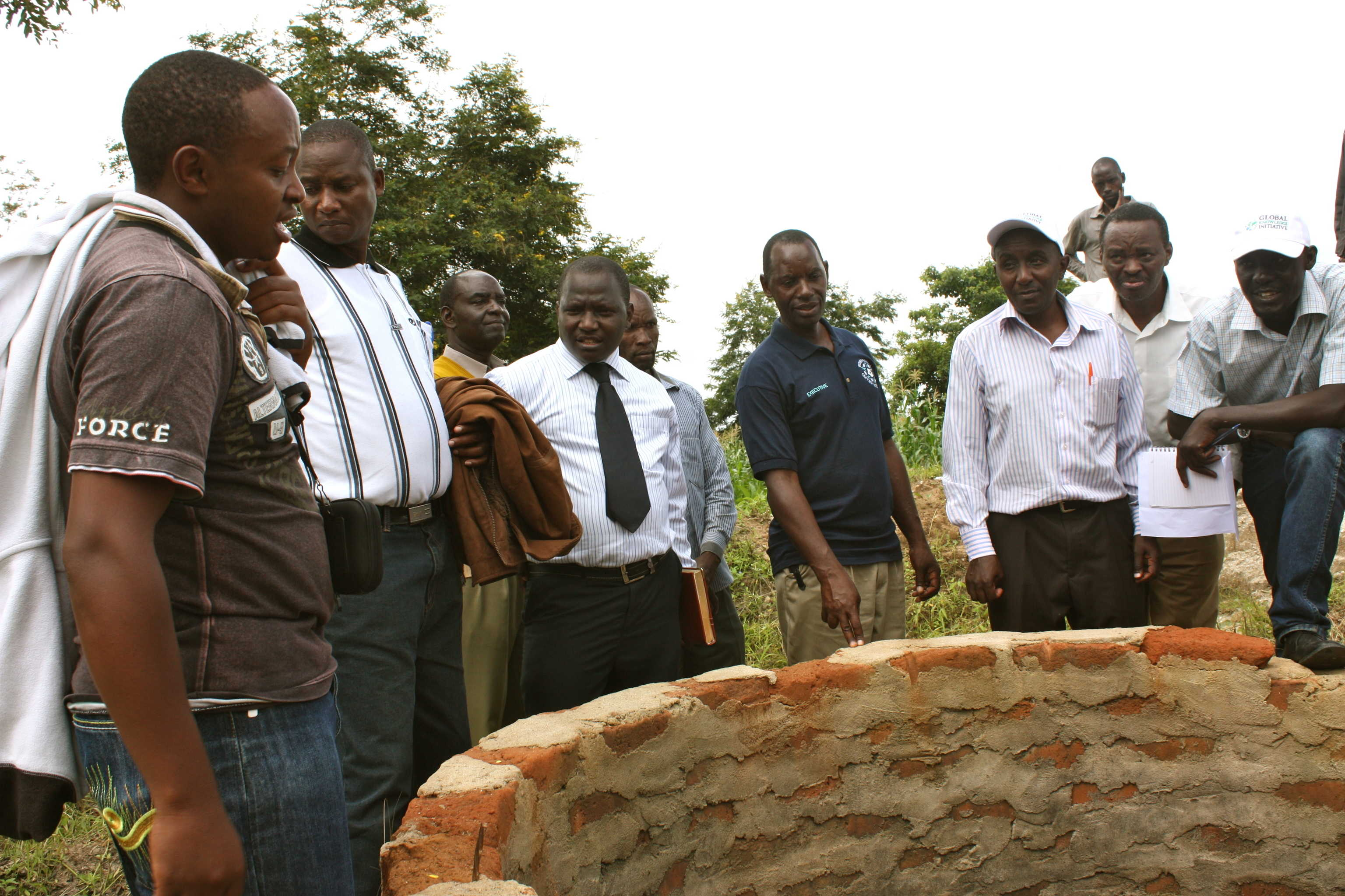 Kenyatta University research team looks at shallow well in Kitui County. Photo: GKI