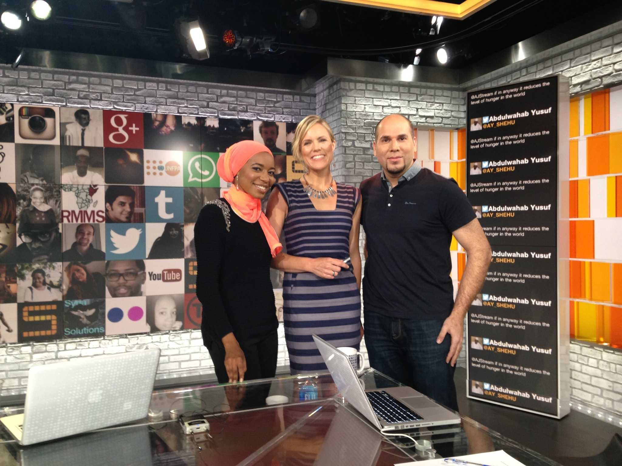 Sara Farley poses on set with The Stream hosts Malika Balil and Omar Baddar.