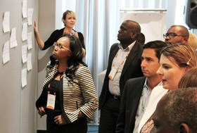 GKI Chief Operating Officer Sara Farley facilitates as The Rockefeller Foundation's Betty Kibaara and Hunter Goldman join other stakeholders to consider the main post harvest loss challenges beckoning for innovation during the YieldWise kickoff convening held in Nairobi, Kenya in April 2016. (Photo Credit: GKI)