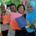 Researchers from UTM use collaborative innovation skills to engage the community of Air Papan, Malaysia. Photo Credit: GKI
