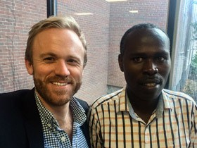 GKI Senior Program Officer Andrew Gerard (left) and Potato Taste Challenge Prize winner Joseph Bigirimana (right). Photo: GKI